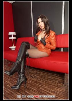 German Milf Stella van Gent shows off in black Overknee Boots