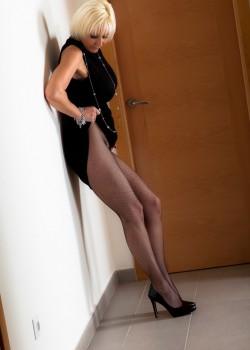 Blonde Milf Jan Burton strips out of her black Pantyhose